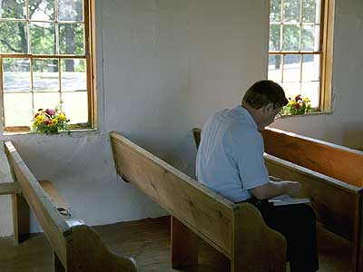 Man sitting in pew
